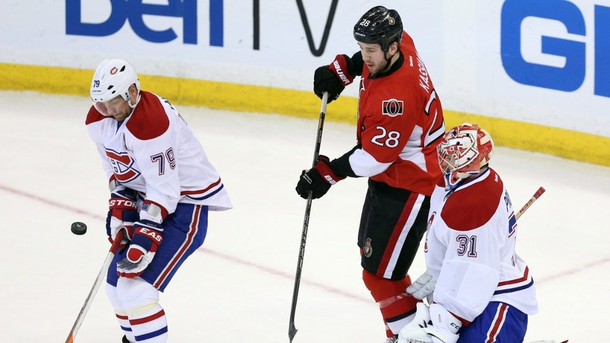 Ottawa Senators' Matt Kassian (28) watches as Montreal Canadiens' Andrei Markov blocks a shot in front Canadiens goaltender Carey Price (31) during the first period of Game 4 of an NHL hockey Stanley Cup playoff series in Ottawa, Ontario, on Tuesday, May 7, 2013. (AP Photo/The Canadian Press, Fred Chartrand)