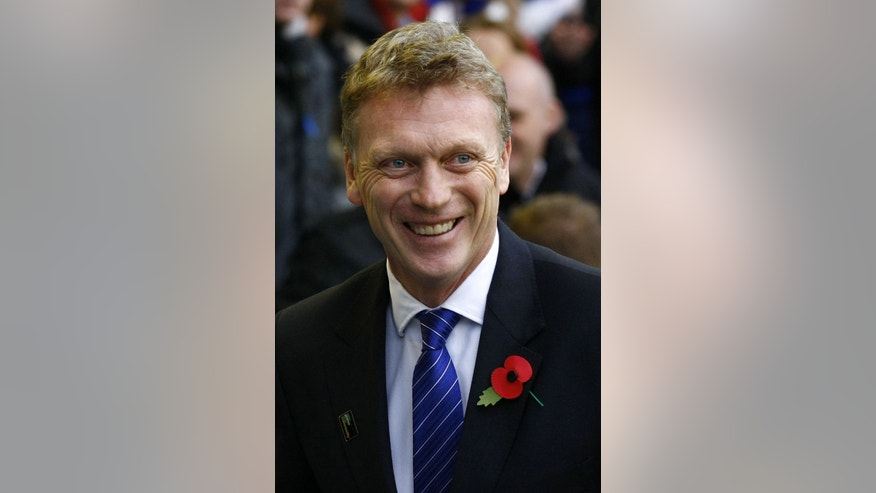 FILE - This is a Saturday Oct. 29, 2011 file photo of Everton manager David Moyes as he  looks on before their English Premier League soccer match against Manchester United at Goodison Park, Liverpool, England.  Everton said Thursday May 9, 2013 that its  manager David Moyes is leaving the club at the end of the season and wants to replace Alex Ferguson at Manchester United. While United has not yet made an announcement on who will succeed Ferguson at Old Trafford, the statement from Everton clears the way for Moyes to be hired. (AP Photo/Tim Hales, File)