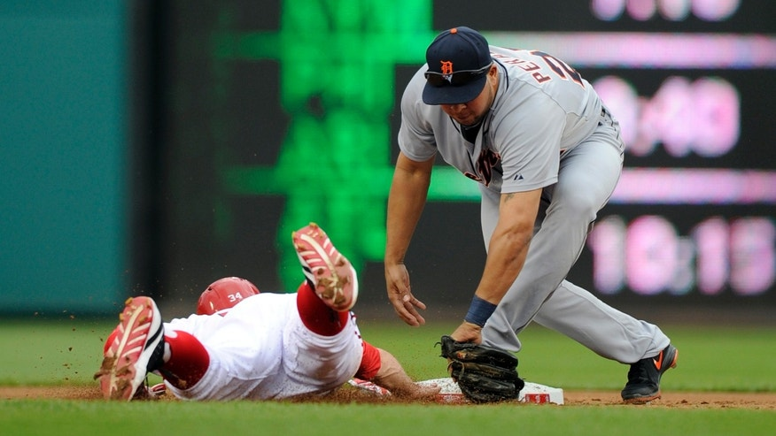 Washington Nationals' Bryce Harper, left, is safe on an attempted pick-off play at second by Detroit Tigers shortstop Jhonny Peralta, right, during the first inning of a baseball game, Thursday, May 9, 2013, in Washington. (AP Photo/Nick Wass)