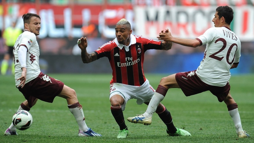 MILAN, ITALY - MAY 05:  Kevin-Prince Boateng (C) of AC Milan in action against Giuseppe Vives (R) and Matteo Brighi of Torino FC during the Serie A match between AC Milan and Torino FC at San Siro Stadium on May 5, 2013 in Milan, Italy.  (Photo by Valerio Pennicino/Getty Images)