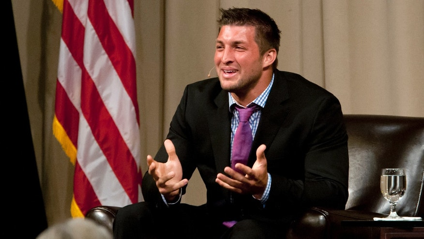 Quarterback Tim Tebow speaks to the Economic Club of Southwest Michigan on Thursday, May 9, 2013, at the Mendel Center at Lake Michigan College near Benton Harbor, Mich. Tebow was released by the New York Jets last month after the team selected West Virginia quarterback Geno Smith in the second round of the NFL football draft. (AP Photo/South Bend Tribune, James Brosher)