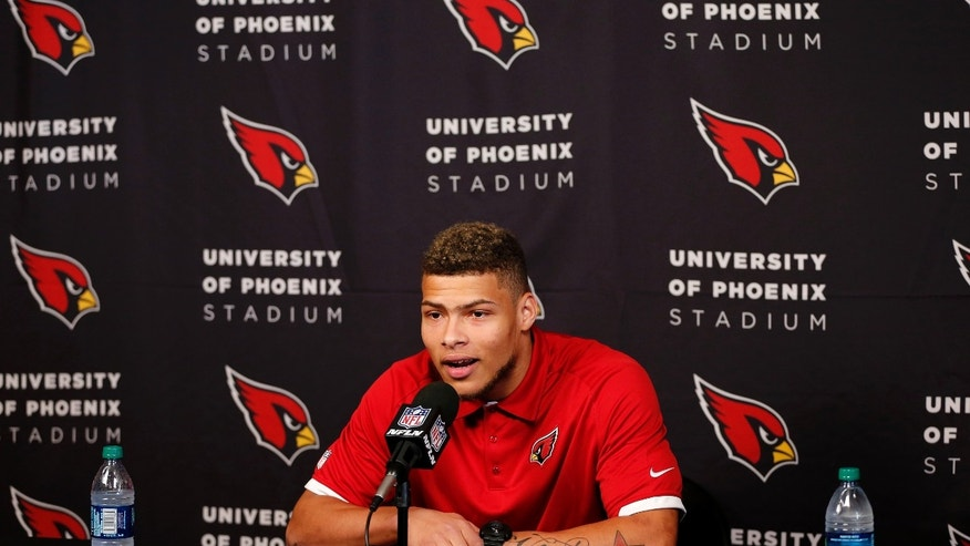 Arizona Cardinals third-round draft pick Tyrann Mathieu speaks during an NFL football news conference, Thursday, May 9, 2013, at the teams' training facility in Tempe, Ariz. (AP Photo/Matt York)