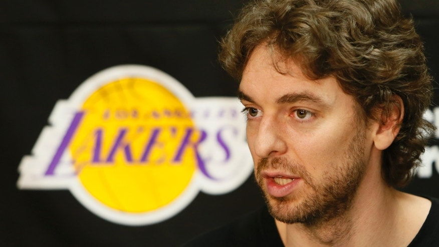 Los Angeles Lakers power forward Pau Gasol talks to reporters during an NBA basketball news conference in El Segundo, Calif., Tuesday, April 30, 2013. The Lakers lost their first-round playoff series to the San Antonio Spurs. (AP Photo/Damian Dovarganes)