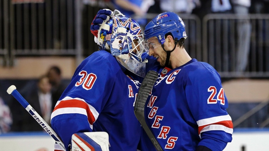 New York Rangers right wing Ryan Callahan (24) celebrates with goalie Henrik Lundqvist (30), of Sweden, after their 4-3 win over the Washington Capitals at the end of Game 4 of their first-round NHL hockey Stanley Cup playoff series in New York, Wednesday, May 8, 2013. (AP Photo/Kathy Willens)