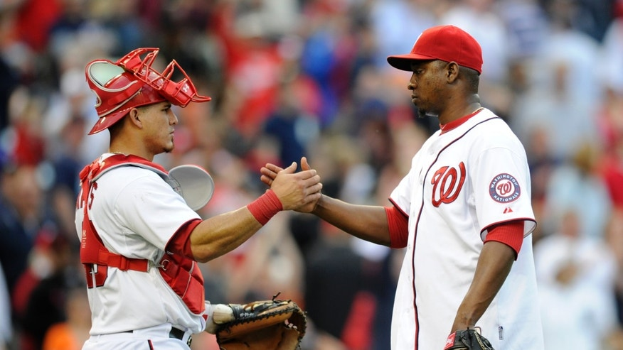 Washington Nationals relief pitcher Rafael Soriano, right, celebrates a 5-4 win over the Detroit Tigers with catcher Wilson Ramos, left, in a baseball game, Thursday, May 9, 2013, in Washington. (AP Photo/Nick Wass)