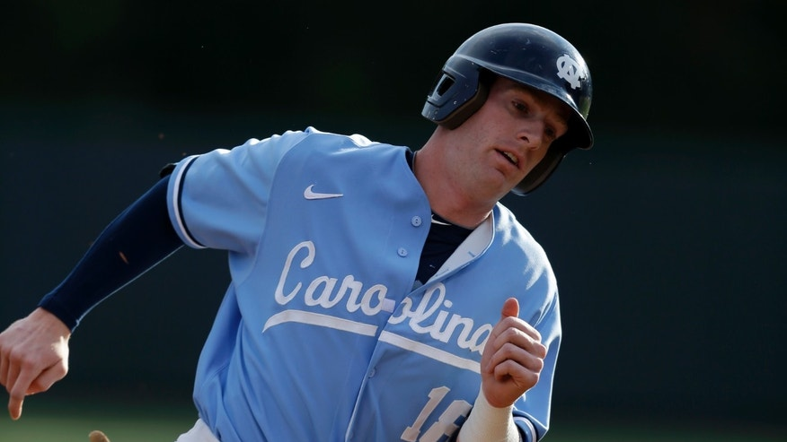In this photo taken Tuesday, May 7, 2013, North Carolina third baseman Colin Moran rounds third base en route to a run during the first inning of an NCAA college baseball game against James Madison in Chapel Hill, N.C. Moran currently leads the nation in both runs scored and RBIs. (AP Photo/Gerry Broome)