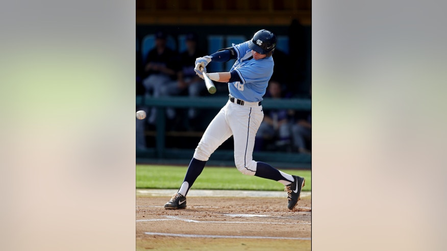 In this photo taken Tuesday, May 7, 2013, North Carolina third baseman Colin Moran gets a base hit during the first inning of an NCAA college baseball game against James Madison in Chapel Hill, N.C. Moran currently leads the nation in both runs scored and RBIs. (AP Photo/Gerry Broome)