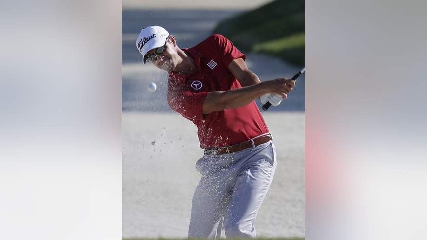 Adam Scott of Australia hits from an 11th hole sand trap  during the first round of The Players championship golf tournament at TPC Sawgrass, Thursday, May 9, 2013 in Ponte Vedra Beach, Fla. (AP Photo/Chris O'Meara)