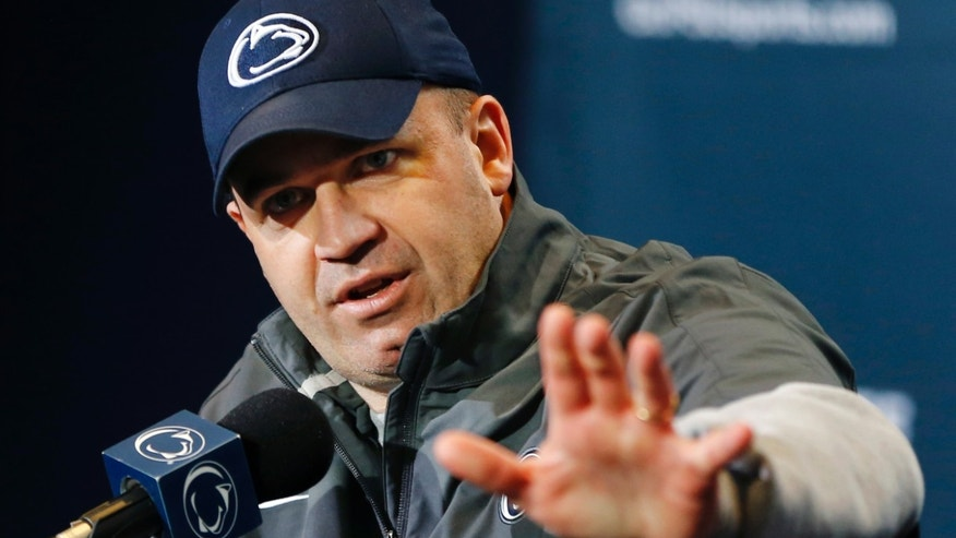 FILE - In this April 20, 2013, file photo, Penn State head coach Bill O'Brien answers questions during a news conference following their spring NCAA college football scrimmage in State College, Pa. Penn State has 67 scholarship football players on its roster and O'Brien said Wednesday, May 8, that he sees no reason why that will change significantly by the time the season starts on Aug. 31. (AP Photo/Keith Srakocic, File)