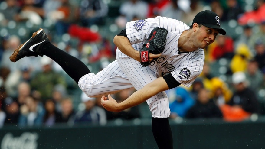 Colorado Rockies starting pitcher Jeff Francis works against the New York Yankees in the first inning of a baseball game in Denver, Thursday, May 9, 2013. (AP Photo/David Zalubowski)