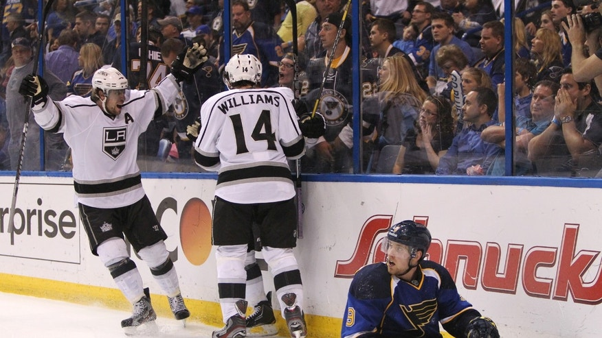 Los Angeles center Anze Kopitar (left) joins teammates Justin Williams and Slava Voynov (obscured) in celebrating Voynov's game-winning goal in overtime during Game 5 of the Western Conference quarterfinals between the St. Louis Blues and the Los Angeles Kings on Wednesday, May 8, 2013, at the Scottrade Center in St. Louis.  At right is Blues left wing Jaden Schwartz. (AP Photo/St. Louis Post-Dispatch, Chris Lee)
