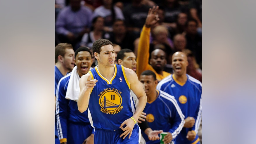 Golden State Warriors' Klay Thompson (11) celebrates a basket against the San Antonio Spurs during the first half in Game 2 of their Western Conference semifinal NBA basketball playoff series, Wednesday, May 8, 2013, in San Antonio. (AP Photo/Eric Gay)