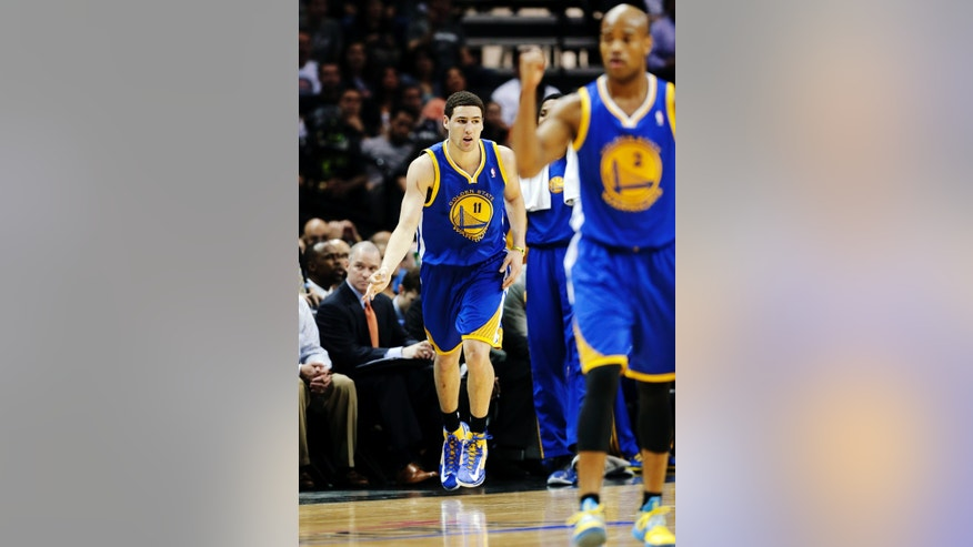 Golden State Warriors' Klay Thompson (11) and Jarrett Jack (2) react after scoring against the San Antonio Spurs during the first half of Game 2 in their Western Conference semifinal NBA basketball playoff series, Wednesday, May 8, 2013, in San Antonio. (AP Photo/Eric Gay)