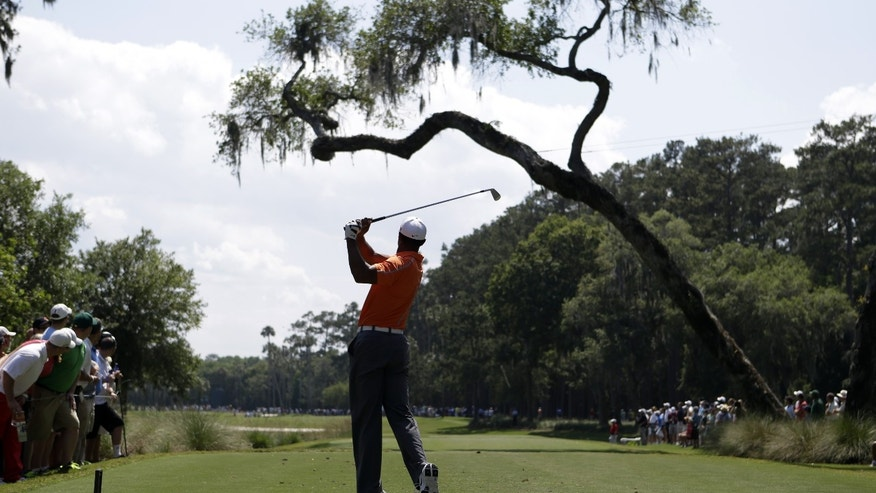 Tiger Woods hits from the sixth tee during the first round of The Players Championship golf tournament at TPC Sawgrass, Thursday, May 9, 2013 in Ponte Vedra Beach, Fla. (AP Photo/John Raoux)