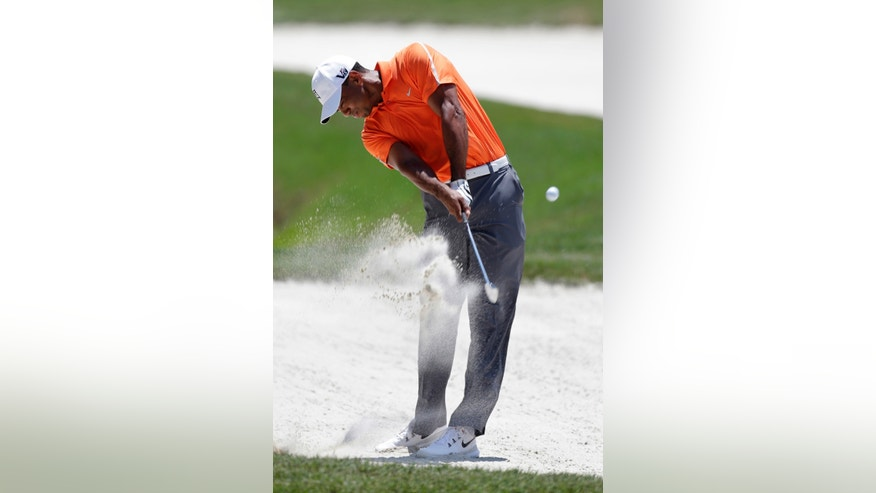 Tiger Woods hits from sand trap on the first fairway during the first round of The Players championship golf tournament at TPC Sawgrass, Thursday, May 9, 2013, in Ponte Vedra Beach, Fla. (AP Photo/Chris O'Meara)