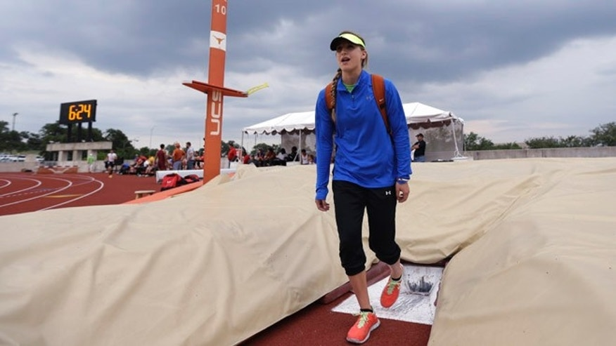 May 10, 2013: Emory Rains High School&#39&#x3b;s Charlotte Brown, 15, gets a feel for the pole vault pit at the UIL State Track &amp&#x3b; Field meet in Austin, Texas.