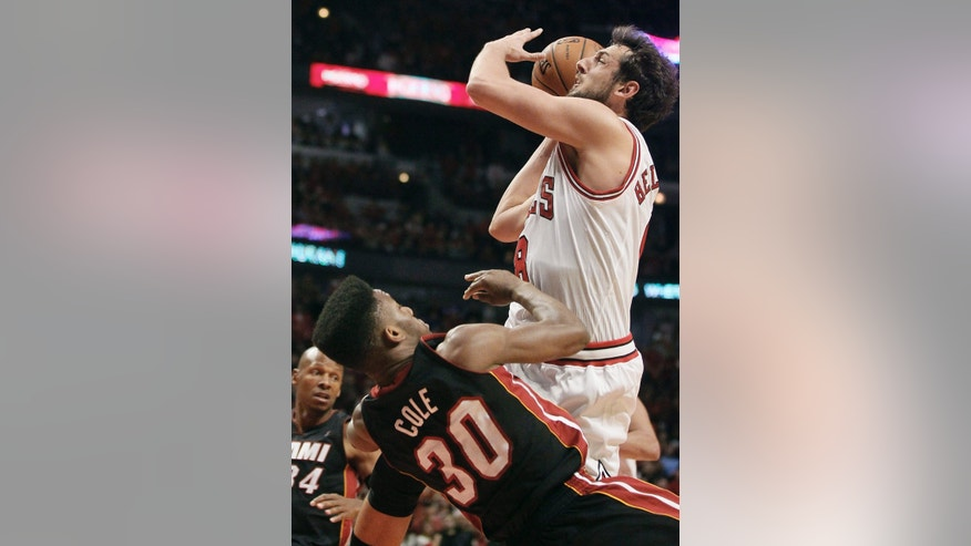 Chicago Bulls shooting guard Marco Belinelli (8) shoots over Miami Heat point guard Norris Cole (30) during the second half of Game 3 of an NBA basketball playoffs Eastern Conference semifinal on Friday, May 10, 2013, in Chicago. (AP Photo/Charles Rex Arbogast)
