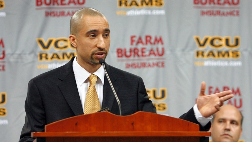 FILE - In this April 2, 2009, file photo, former Florida assistant basketball coach Shaka Smart addresses the media during a news conference, as VCU athletic director Norwood Teague, right, looks, after Smart was introduced as the new men's basketball coach at Virginia Commonwealth University in Richmond, Va.  Smart was a two-time attendee of the Villa 7 program while an assistant at Clemson and then Florida. The relationship he developed then with Teague at the program, was the catalyst for Smart's rise to fame.  (AP Photo/ Richmond Times-Dispatch, Dean Hoffmeyer, File)