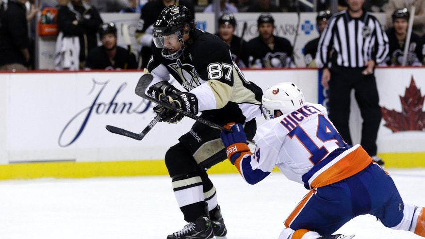 Pittsburgh Penguins' Sidney Crosby (87) gets past New York Islanders' Thomas Hickey (14) on a breakaway for a goal in the second period of Game 5 of an NHL hockey Stanley Cup first-round playoff series, Thursday, May 9, 2013, in Pittsburgh. (AP Photo/Gene J. Puskar)