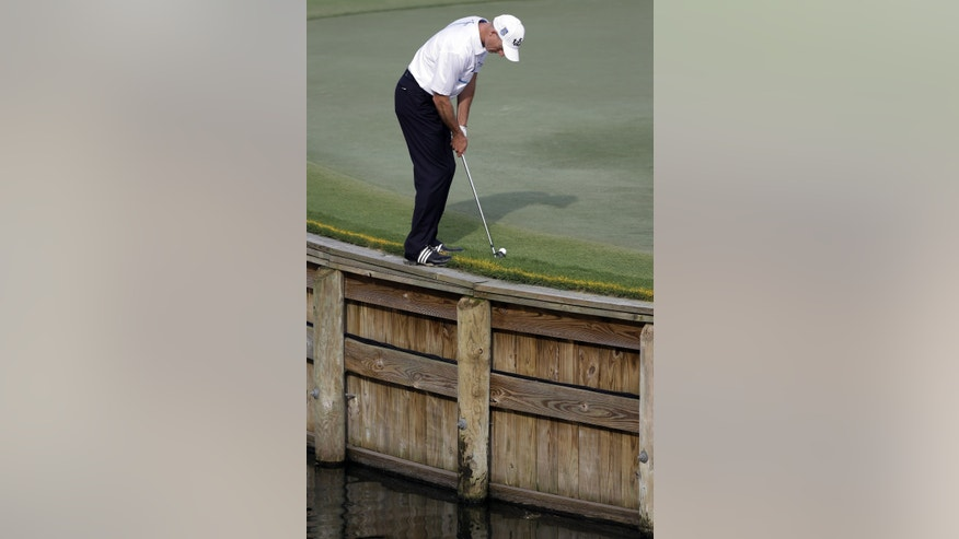 Jim Furyk putts from the rough on the 17th hole during the second round of The Players championship golf tournament at TPC Sawgrass, Friday, May 10, 2013, in Ponte Vedra Beach, Fla. (AP Photo/John Raoux)