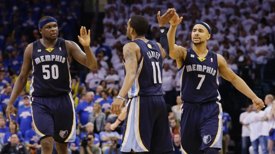 Memphis Grizzlies' Mike Conley (11) celebrates with teammates Zach Randolph (50) and Jerryd Bayless (7) after scoring a basket late in the second half of Game 2 of their Western Conference semifinal NBA basketball playoff series Tuesday, May 7, 2013, in Oklahoma City. The Grizzlies won 99-93. (AP Photo/Tony Gutierrez)