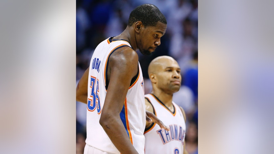 Oklahoma City Thunder's Kevin Durant, front, and Derek Fisher, back, react to loosing to the Memphis Grizzlies in Game 2 of their Western Conference Semifinals NBA basketball playoff series in Oklahoma City, Tuesday, May 7, 2013.  Memphis won 99-93.  (AP Photo/Alonzo Adams)