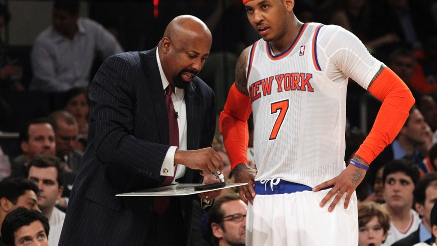New York Knicks head coach Mike Woodson, left, gives Carmelo Anthony instruction in the second half of Game 2 of their NBA basketball playoff series in the Eastern Conference semifinals against the Indiana Pacers at Madison Square Garden in New York, Tuesday, May 7, 2013. The Knicks won 105-79. (AP Photo/Mary Altaffer)