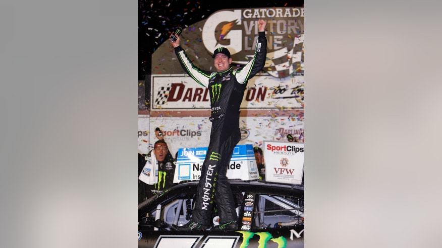 Kyle Busch celebrates in Victory Lane after winning the NASCAR Nationwide series auto race at Darlington Raceway, Friday, May 10, 2013, in Darlington, S.C.  (AP Photo/Mic Smith)