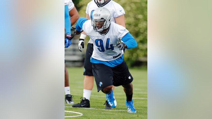 Detroit Lions rookie defensive end Ezekiel Ansah (94) takes part in a drill during NFL football rookie minicamp at the team's practice facility in Allen Park, Mich., Friday, May 10, 2013. Ansah was the fifth overall pick in the NFL draft. (AP Photo/Duane Burleson)