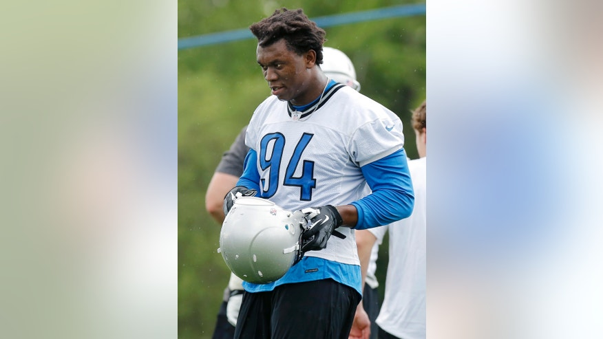 Detroit Lions rookie defensive end Ezekiel Ansah (94) takes a break during a workout at NFL football rookie minicamp at the team's practice facility in Allen Park, Mich., Friday, May 10, 2013. Ansah was the fifth overall pick in the NFL draft. (AP Photo/Duane Burleson)