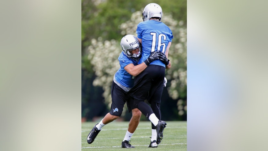 Detroit Lions' Corey Fuller, left, tackles Ryan Nehlen during a drill for rookie wide receivers at the team's NFL football practice facility in Allen Park, Mich., Friday, May 10, 2013. (AP Photo/Duane Burleson)