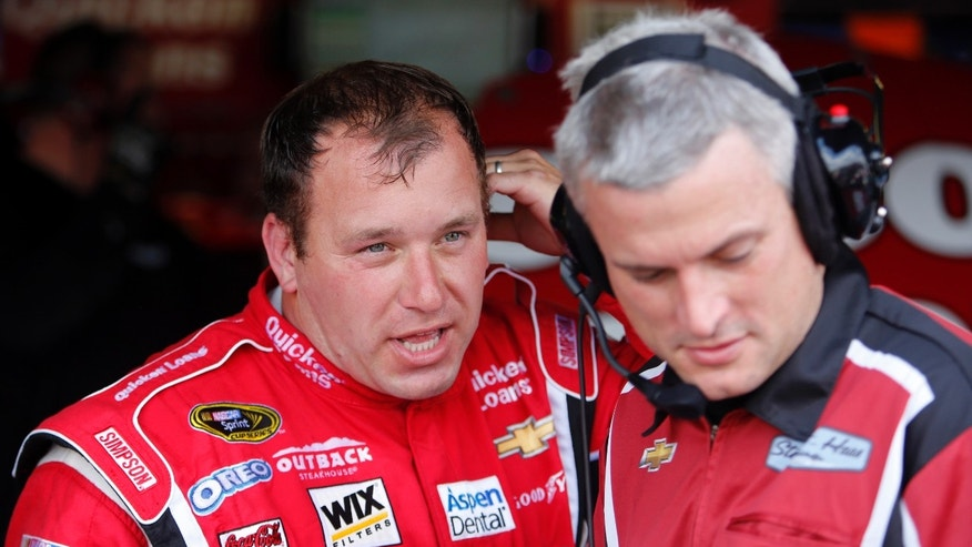 Driver Ryan Newman, left, talks with his crew in the garage area during practice, Friday May 10, 2013, in Darlington, S.C., for Saturday's NASCAR Sprint Cup series auto race. (AP Photo/Mic Smith)