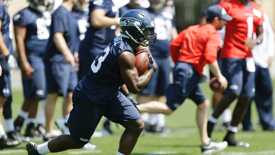 Seattle Seahawks top draft pick, running back Christine Michael runs the ball during practice drills at Seattle Seahawks NFL football rookie minicamp, Friday, May 10, 2013, in Renton, Wash. (AP Photo/Ted S. Warren)