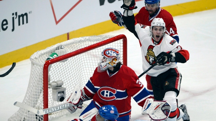Ottawa Senators' Kyle Turris (7) celebrates his goal on Montreal Canadiens goalie Peter Budaj as Canadiens' Tomas Plekanec (14) and P.K. Subban (76) look on during the second period of their Game 5 first round NHL hockey Stanley Cup playoff series in Montreal on Thursday, May 9, 2013. (AP Photo/The Canadian Press, Ryan Remiorz)