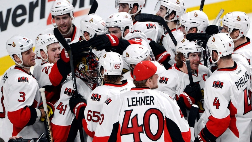 Ottawa Senators celebrate after defeating the Montreal Canadiens 6-1 in Game 5 first round NHL hockey Stanley Cup playoff series, Thursday, May 9, 2013, in Montreal. Ottawa wins the series four games to one. (AP Photo/The Canadian Press, Ryan Remiorz)