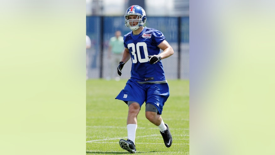 New York Giants safety Cooper Taylor runs during NFL football rookie minicamp, Friday, May 10, 2013, in East Rutherford, N.J. (AP Photo/Julio Cortez)