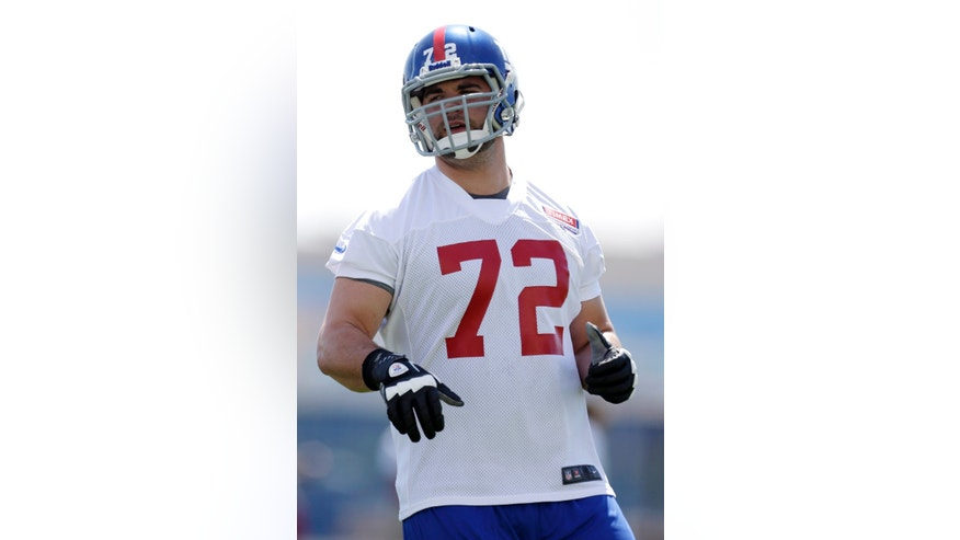 New York Giants first-round draft Justin Pugh, an offensive tackle out of Syracuse, jogs during NFL football rookie minicamp, Friday, May 10, 2013, in East Rutherford, N.J. (AP Photo/Julio Cortez)