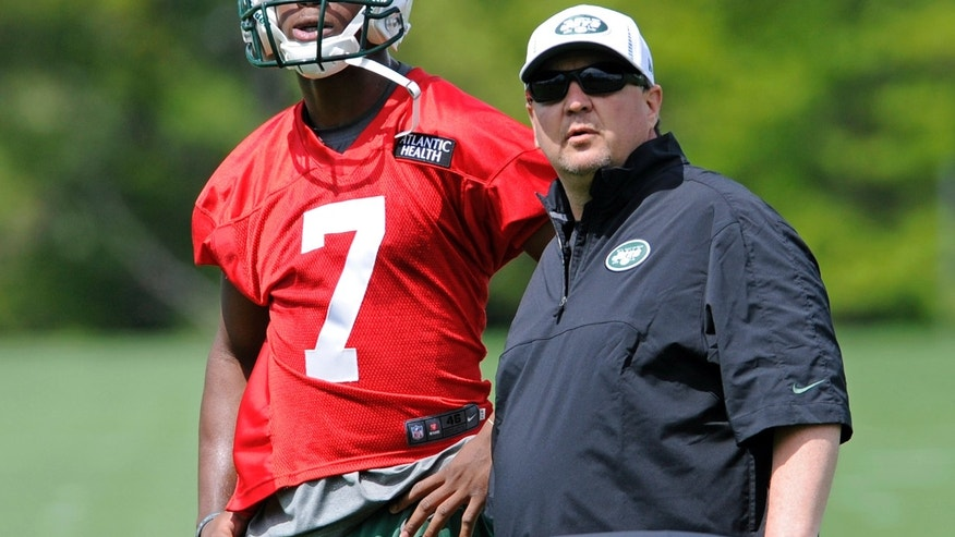 New York Jets quarterback Geno Smith, left,  a second-round draft pick out of West Virginia, and offensive coordinator Marty Mornhinweg look on during NFL football rookie minicamp Friday, May 10, 2013, in Florham Park, N.J. (AP Photo/Bill Kostroun)
