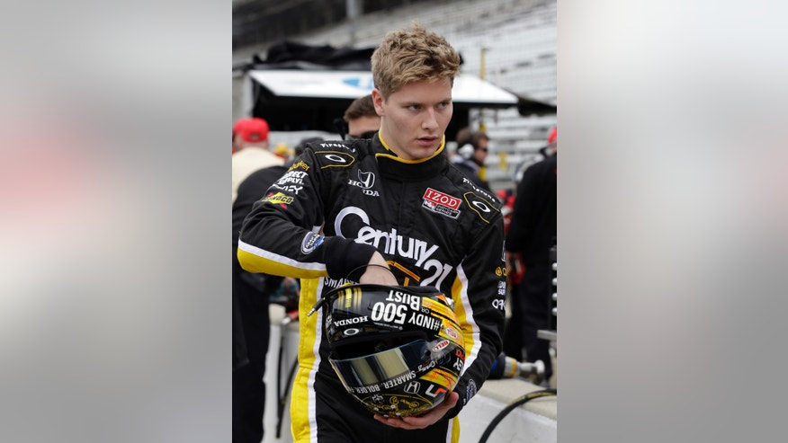 Josef Newgarden prepares to drive as he waits for the track to open on the opening day of practice for the IndyCar Indianapolis 500 auto race on opening day at the Indianapolis Motor Speedway in Indianapolis, Saturday, May 11, 2013. (AP Photo/Darron Cummings)