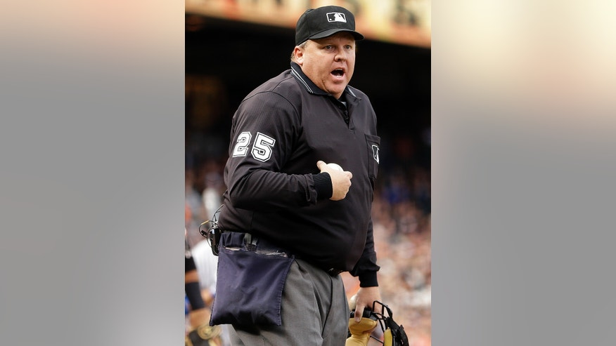 FILE - In this May 5, 2013, file photo, home plate umpire Fieldin Culbreth yells at the Los Angeles Dodgers dugout during the second inning of a baseball game between the Dodgers and San Francisco Giants in San Francisco. Major League Baseball suspended Culbreth for two games on Friday, May 10, 2013, because he was in charge of the crew that allowed Houston Astros manager Bo Porter to improperly switch relievers in the middle of an inning.  (AP Photo/Ben Margot, File)