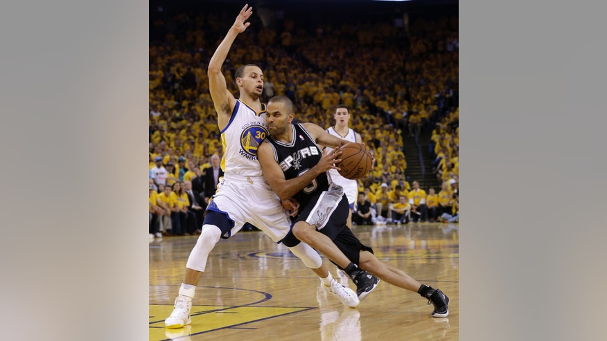 San Antonio Spurs guard Tony Parker (9) drives against Golden State Warriors shooting guard Stephen Curry (30) during the second quarter of Game 3 of a Western Conference semifinal NBA basketball playoff series in Oakland, Calif., Friday, May 10, 2013. (AP Photo/Jeff Chiu)