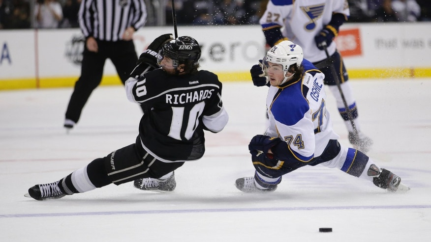 Los Angeles Kings' Mike Richards, left, and St. Louis Blues' T.J. Oshie fall to the ice during the third period in Game 6 of a first-round NHL hockey Stanley Cup playoff series in Los Angeles, Friday, May 10, 2013. The Kings won 2-1. (AP Photo/Jae C. Hong)