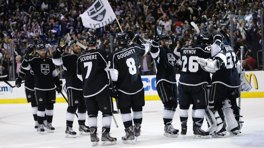 The Los Angeles Kings celebrate their team's 2-1 win against the St. Louis Blues after Game 6 of a first-round NHL hockey Stanley Cup playoff series in Los Angeles, Friday, May 10, 2013. (AP Photo/Jae C. Hong)