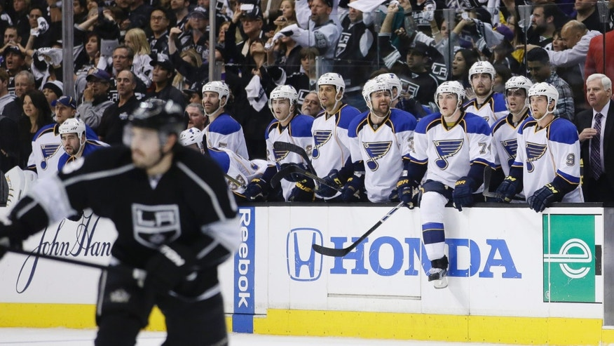 The St. Louis Blues players watch in the last seconds of Game 6 of a first-round NHL hockey Stanley Cup playoff series against the Los Angeles Kings in Los Angeles, Friday, May 10, 2013. The Kings won 2-1. (AP Photo/Jae C. Hong)