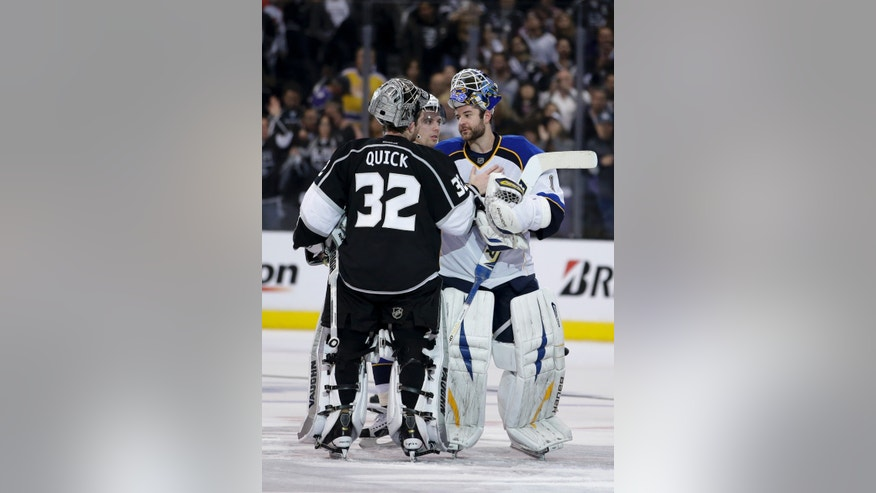 Los Angeles Kings goalie Jonathan Quick, left, is congratulated by St. Louis Blues goalie Brian Elliott after Game 6 of a first-round NHL hockey Stanley Cup playoff series in Los Angeles, Friday, May 10, 2013. The Kings won 2-1. (AP Photo/Jae C. Hong)