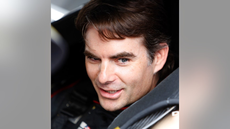 Jeff Gordon, who was making his 700th career start in NASCAR's top series, sits in his car before the Sprint Cup series auto race at Darlington Raceway, Saturday, May 11, 2013, in Darlington, S.C.  (AP Photo/Mic Smith)