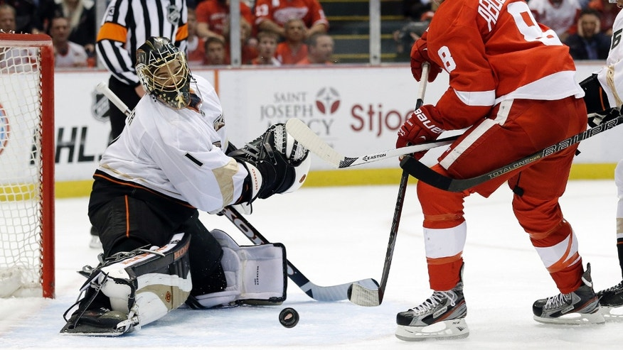 Anaheim Ducks goalie Jonas Hiller (1), of Switzerland,  stops a shot by Detroit Red Wings left wing Justin Abdelkader (8) in the second period in Game 6 of a first-round NHL hockey Stanley Cup playoff series in Detroit, Friday, May 10, 2013. (AP Photo/Paul Sancya)