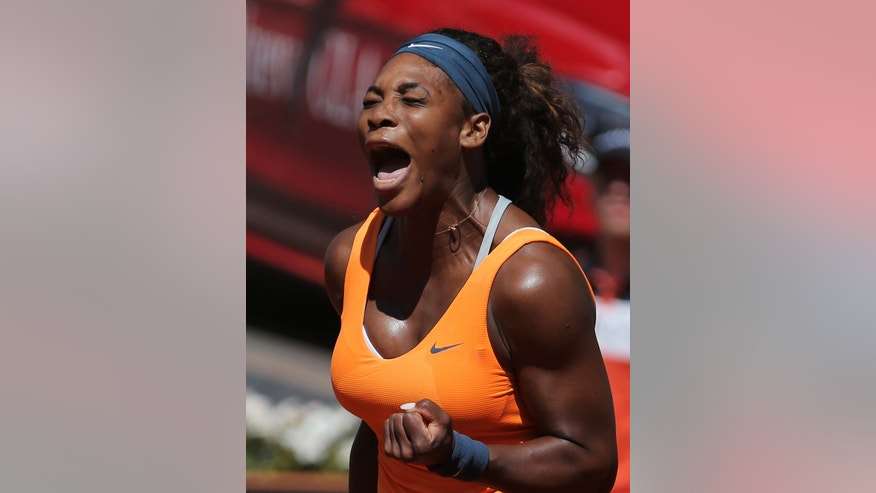 Serena Williams from the U.S. reacts after winning a point during a match against Sara Errani from Italy at the Madrid Open tennis tournament, in Madrid, Saturday, May 11, 2013. (AP Photo/Andres Kudacki)