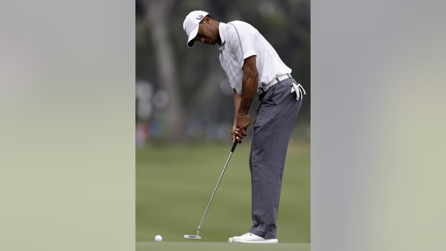 Tiger Woods putts on the sixth green for par during the third round of The Players championship golf tournament at TPC Sawgrass, Saturday, May 11, 2013, in Ponte Vedra Beach, Fla. (AP Photo/Gerald Herbert)