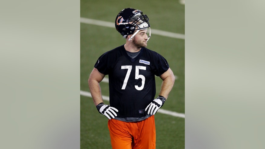 Chicago Bears' Kyle Long (75) looks around as he walks off the field at NFL football rookie minicamp at Halas Hall in Lake Forest, Ill., Friday, May 10, 2013. (AP Photo/Nam Y. Huh)